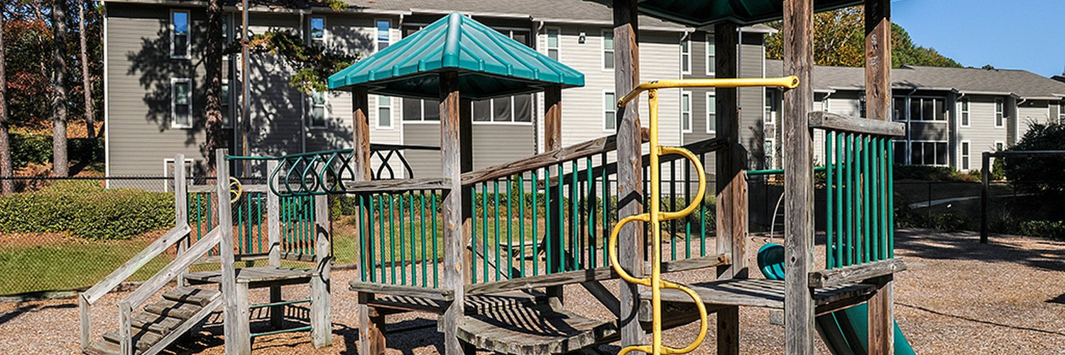 Combination playground structure for small children; slides, climbers (stairs in this case)